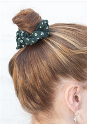 Picture of Brandy Melville Green Scrunchie with white floral print.